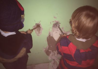 boys demolishing wall